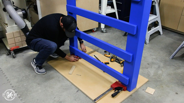 attaching clamps to base of loft bed