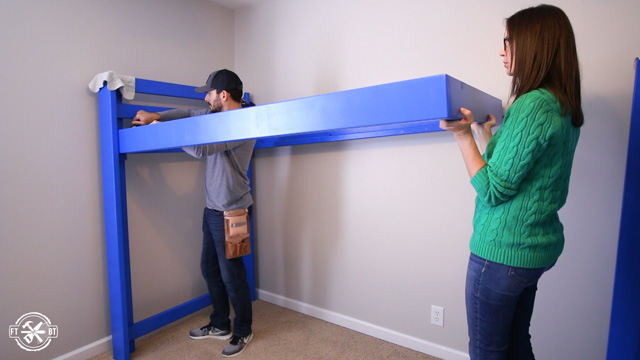 assembling loft bed in room