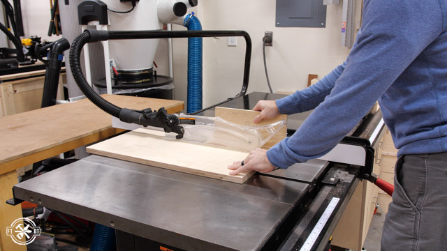 cutting wood pieces on the table saw