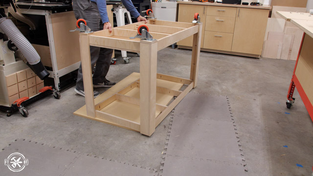 putting table frame on table top