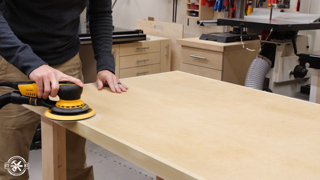 sanding the top and sides of table
