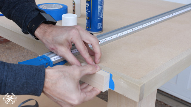 attaching sacrificial wood block to edge of table