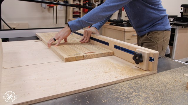 cutting wood with table saw sled