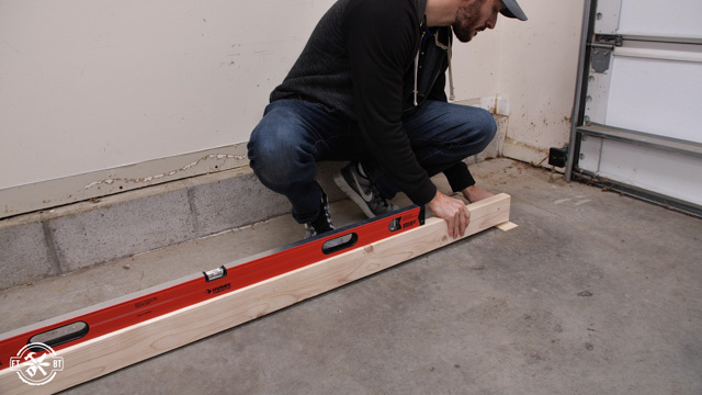 using level, 2x4 and shims to find slope in garage