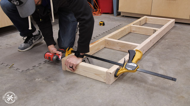 screwing together 2x4s for garage shelf