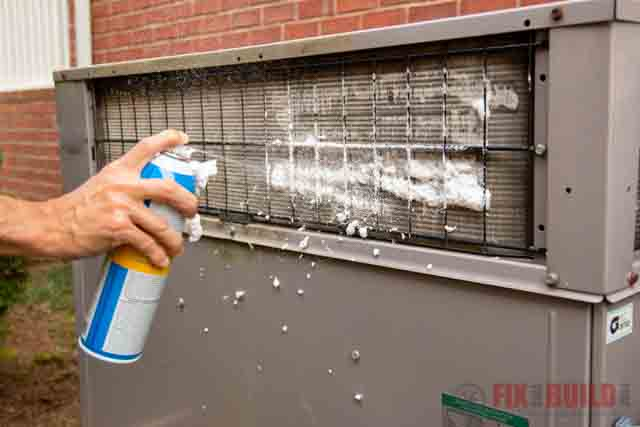 spraying foaming cleaner on HVAC