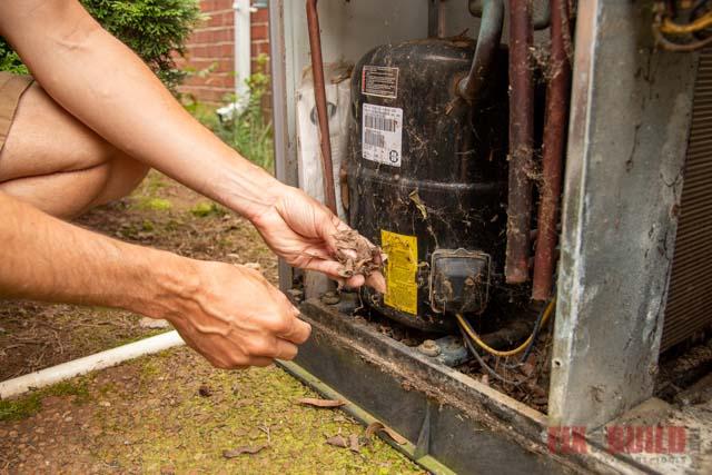removing debris from inside HVAC unit