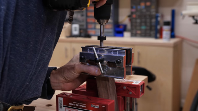 Drilling holes with self centering jig