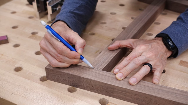 Marking wood to add holes for wood dowels