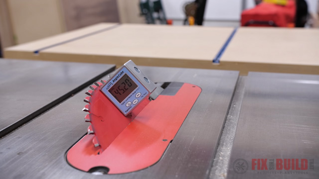 Adjusting table saw blade with digital angle blade