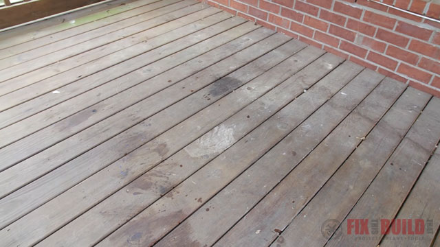 weathered wooden deck with stains