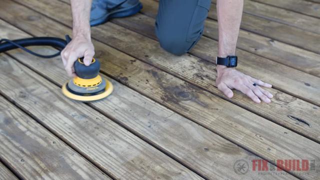 using an orbital sander on a deck