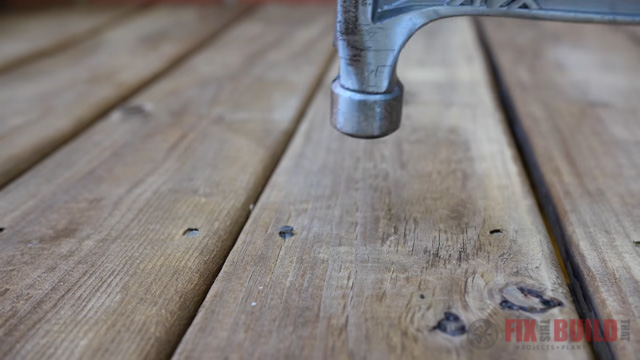 driving nails into deck boards