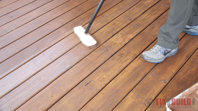 putting second coat of stain on deck