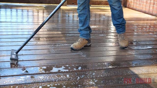scrubbing deck with deck brush