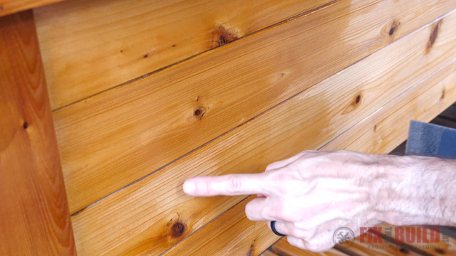 pointing out uneven coverage of varnish on wooden furniture