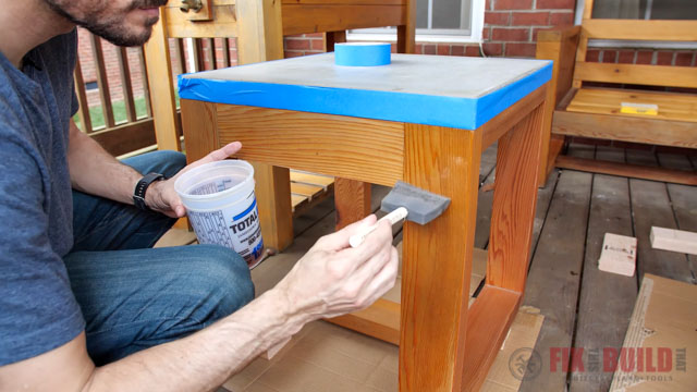 applying varnish to wooden outdoor furniture