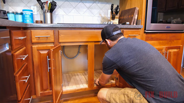 attaching base in cabinet