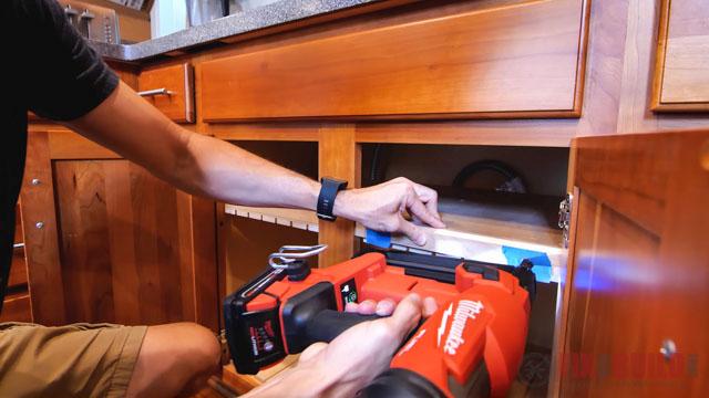 adding trim to diy cutting board storage