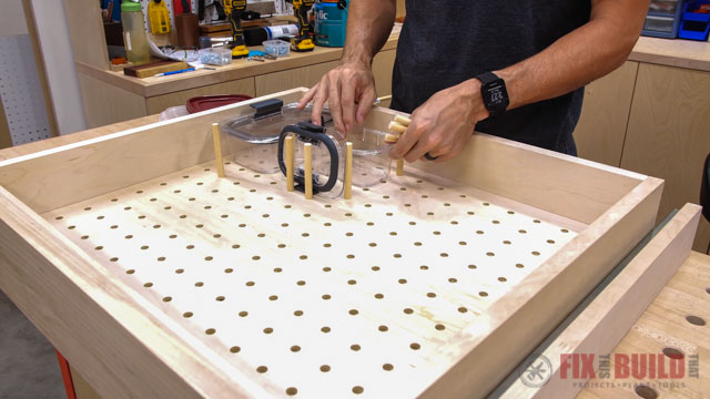 putting dowels in pegboard