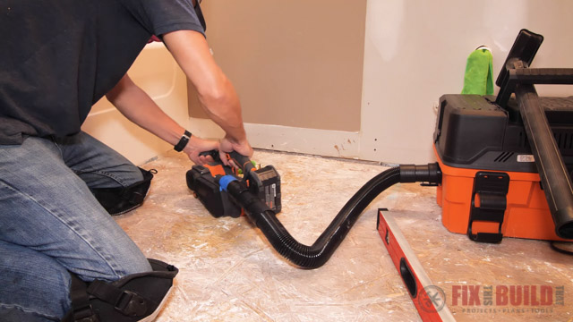 using belt sander to level floors