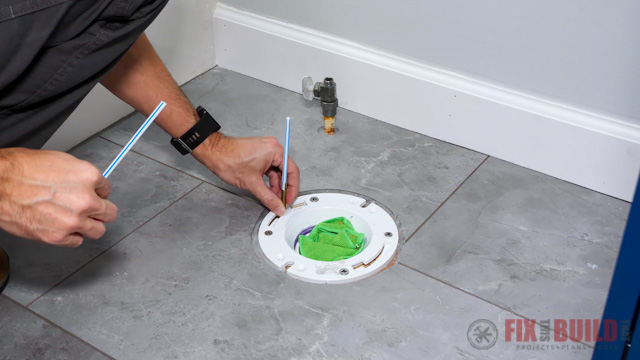 putting straws on toilet base bolts for alignment