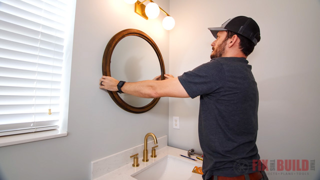 hanging mirror in bathroom