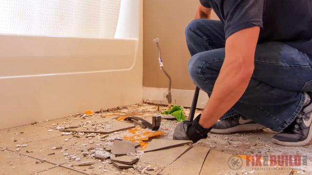 tearing up tile floor