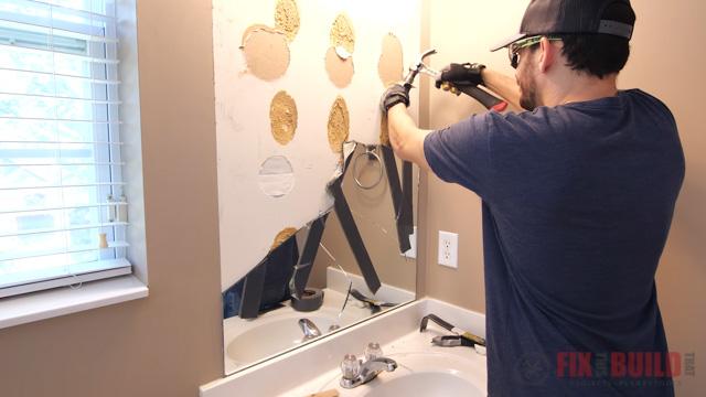 taking mirror off wall