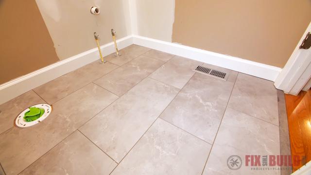 grey vinyl plank flooring in a bathroom