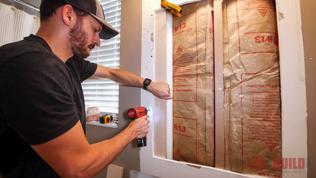 adding scrap wood to drywall opening
