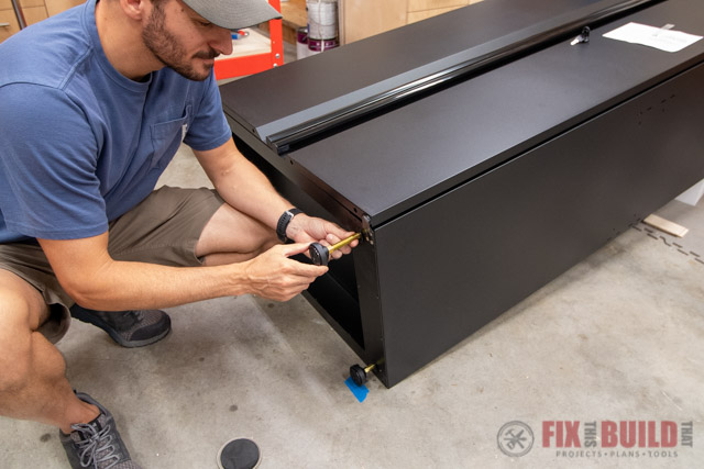 leveling the feet of garage storage cabinet