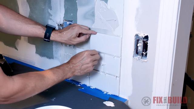 attaching backsplash tiles to wall