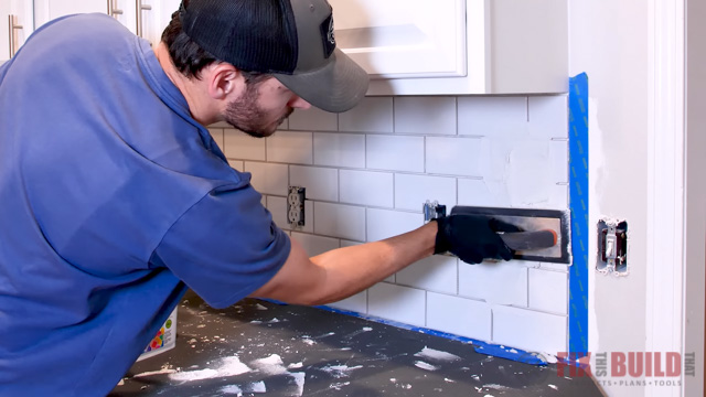 applying grout to tile