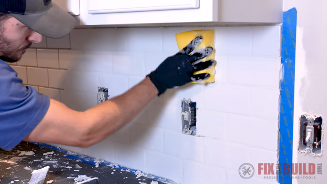 removing layer of grout from tile