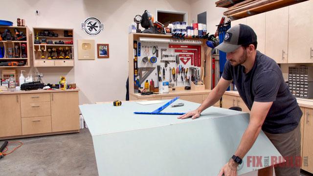cutting drywall in workshop